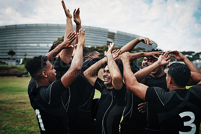 Buy stock photo Cropped shot of a team of rugby players celebrating while standing on the field during the day