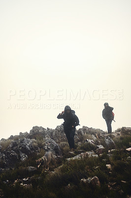 Buy stock photo Shot of two male friends out hiking in the mountains