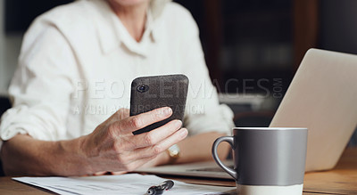Buy stock photo Cropped shot of an unrecognizable woman sitting alone and using a laptop and cellphone at home
