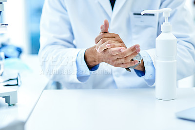 Buy stock photo Closeup shot of an unrecognisable scientist using hand sanitiser in a lab
