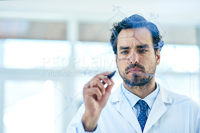 Buy stock photo Shot of a young scientist writing notes on a glass wall in a lab