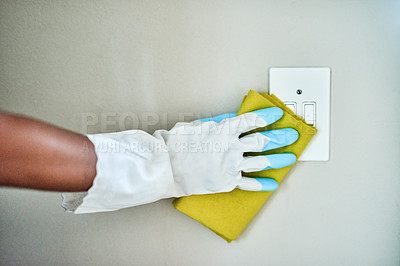 Buy stock photo Cropped shot of an unrecognizable woman cleaning her walls at home
