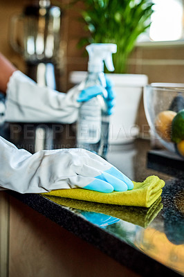 Buy stock photo Cropped shot of an unrecognizable woman cleaning her kitchen counter at home