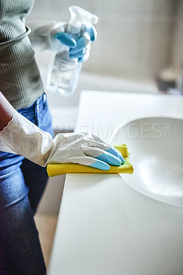 Buy stock photo Cropped shot of an unrecognizable woman cleaning in her bathroom at home