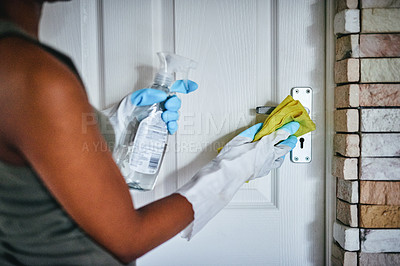 Buy stock photo Cropped shot of an unrecognizable woman cleaning her door at home