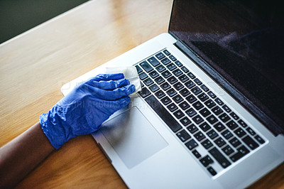 Buy stock photo Cropped shot of an unrecognizable woman cleaning her laptop indoors at home