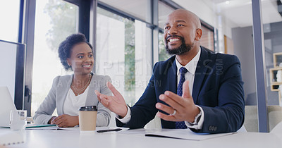 Buy stock photo Cropped shot of a handsome young businessman giving his opinion to his colleagues during a meeting in the office