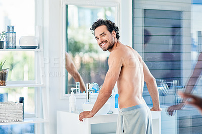 Buy stock photo Portrait of a handsome young man getting ready in the morning inside his bathroom
