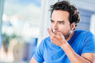 Buy stock photo Cropped shot of a handsome young man smelling his breath in the morning inside the bathroom at home