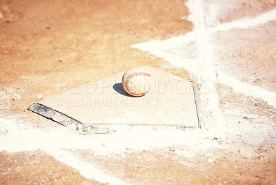 Buy stock photo Shot of a baseball lying on a field during a match
