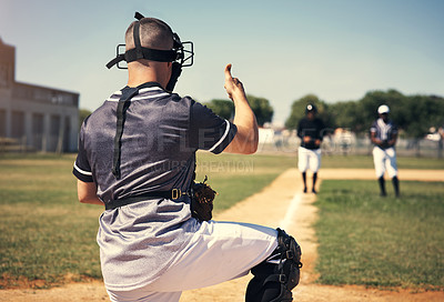 Buy stock photo Rearview shot of a young man giving thumbs up during a baseball match