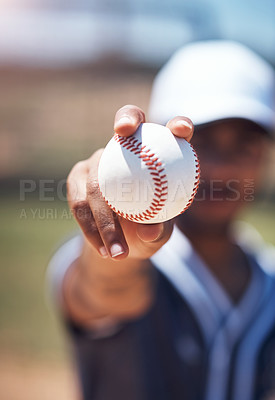 Buy stock photo Shot of a man holding a ball during a baseball match