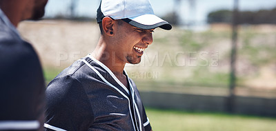 Buy stock photo Shot of a young man playing a game of baseball