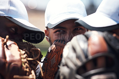 Buy stock photo Shot of a group of young baseball players playing a game together