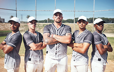 Buy stock photo Portrait of a group of confident young men playing a game of baseball