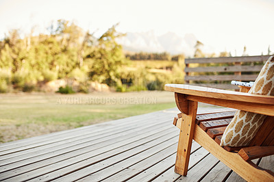 Buy stock photo Shot of wooden chairs on a deck out in a garden