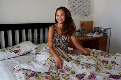 Buy stock photo Shot of a young woman sitting up in her bed after waking up