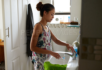 Buy stock photo Shot of a young woman getting ready to brush her teeth in the bathroom at home