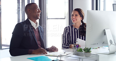 Buy stock photo Shot of two businesspeople working together on a computer in an office