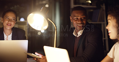 Buy stock photo Shot of a young businessman having a meeting with his colleagues in an office at night