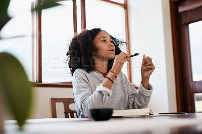 Buy stock photo Cropped shot of a young woman at home