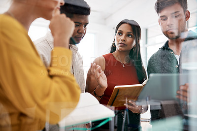 Buy stock photo Shot of a group of businesspeople brainstorming together in an office