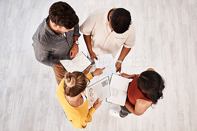 Buy stock photo High angle shot of a group of young designers having a discussion in an office