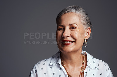 Buy stock photo Studio shot of a senior woman posing against a grey background