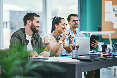 Buy stock photo Shot of a group of young designers listening to a presentation in an office
