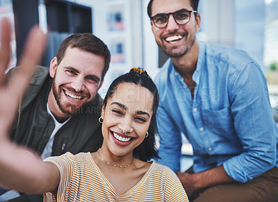 Buy stock photo Shot of a group of designers taking selfies together in an office