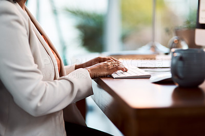 Buy stock photo Cropped shot of an unrecognizable businesswoman working at her desk