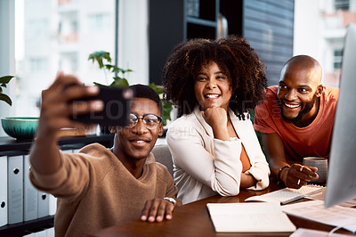 Buy stock photo Shot of a group of designers taking a selfie together