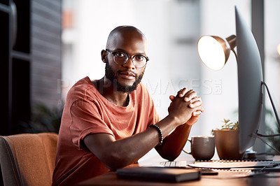 Buy stock photo Portrait of a handsome young businessman sitting at his desk