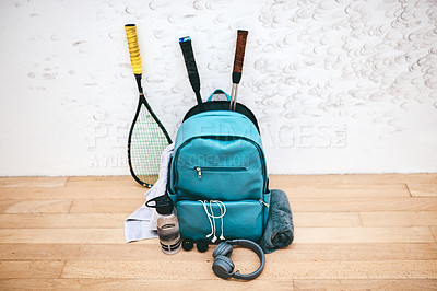 Buy stock photo Shot of a sports bag and other items in an empty squash court