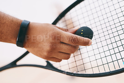 Buy stock photo Cropped shot of a man serving a ball with a racket during a game of squash