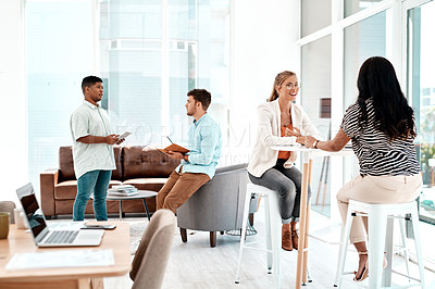 Buy stock photo Full length shot of a group of young businesspeople socializing in their office