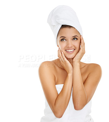 Buy stock photo A gorgeous young woman looking away while wrapped in towels