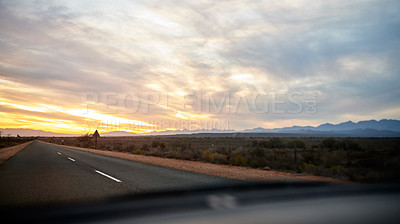Buy stock photo Shot of a vehicle traveling on a road in a rural area