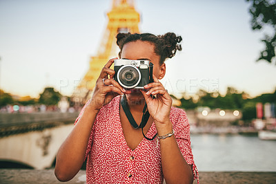 Buy stock photo Shot of an attractive young woman exploring and taking pictures in Paris, France