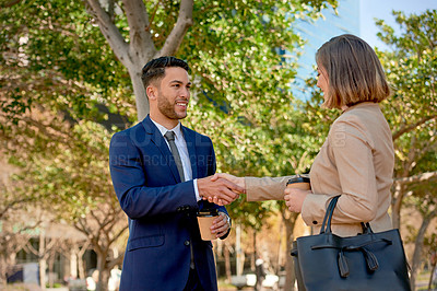 Buy stock photo Shot of two businesspeople shaking hands while standing outdoors