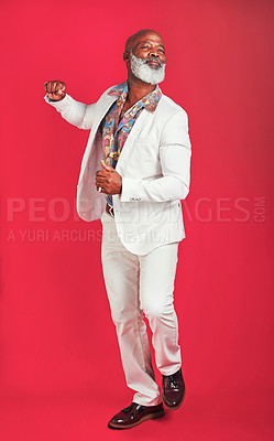 Buy stock photo Studio shot of a man wearing vintage clothes while dancing against a red background