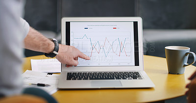 Buy stock photo Rearview shot of an unrecognisable businessman analysing graphs on a laptop in an office