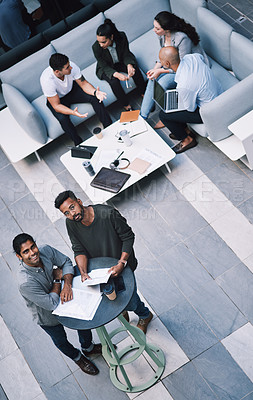Buy stock photo High angle shot of a group of businesspeople having a meeting at a conference