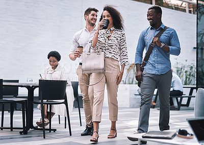 Buy stock photo Shot of a group of young businesspeople walking through a convention centre