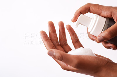 Buy stock photo Studio shot of an unrecognizable woman putting foam on her hands
