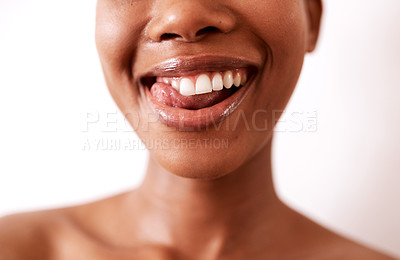 Buy stock photo Closeup shot of a beautiful young woman posing with glossy lips against a white background