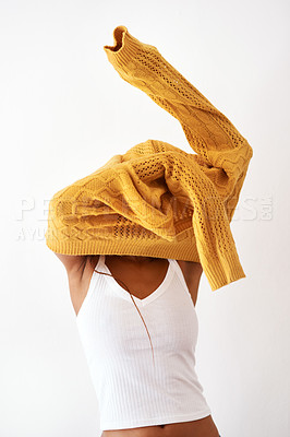 Buy stock photo Studio shot of an unrecognizable woman getting dressed against a white background