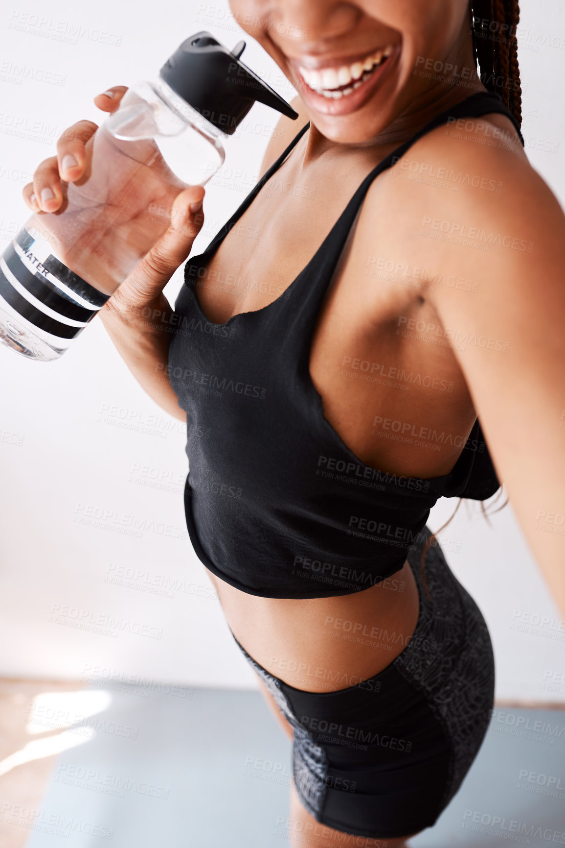 Buy stock photo Selfie view of a woman holding her water bottle while posing in her gym clothes