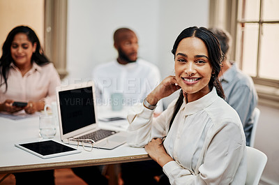 Buy stock photo Portrait of a young businesswoman having a meeting with colleagues in a modern office