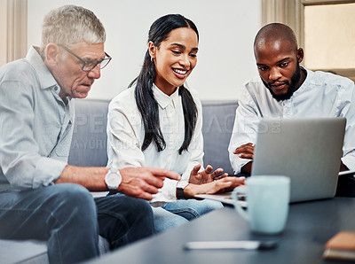 Buy stock photo Shot of a group of businesspeople using a laptop during a meeting on the sofa in a modern office